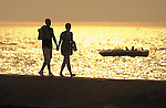 Eighteen-year-olds Tim Zietlow and Kelli DeGraaf, both from Holland, walk the pier at Holland State Park on Friday evening.  Friday was the summer solstice, the longest day of the year..(6/21/02)