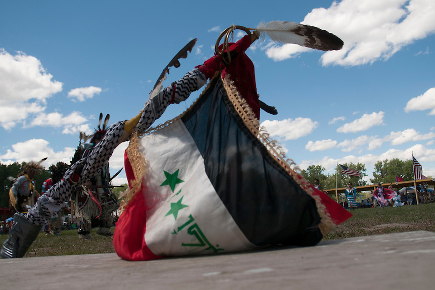 A captures Iraqi flag with eagle feather at the Grand opening of the veteran pow wow in Pine Ridge.John Old Horse recently came back from Iraq with a flag captured in an assault on an Iraqi police station and a kafea taken from a dead Al Qaeda member.