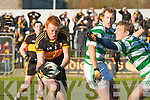 Dr Crokes Johnny Buckley under pressure from  Ballinacourty during their Munster Championship quarter final clash in Dungarvan on Sunday