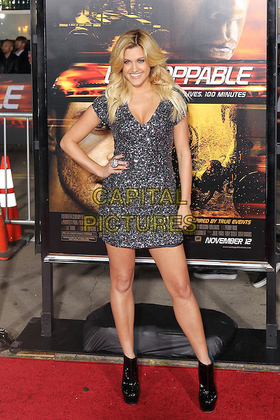 "ASHLEY ROBERTS.Twentieth Century Fox world premiere of Tony Scott's action-thriller, ""Unstoppable,"" at the Regency Village Theater in Westwood. Los Angeles, CA, USA, October 26th, 2010. .full length dress black silver sparkly beaded dress hand on hip ankle boots platform patent sequined sequin ring.CAP/CEL.©CelPh/Capital Pictures."