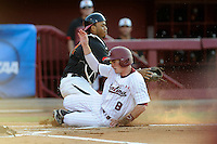Marcus Mooney (8) of the South Carolina Gamecocks slides home in an NCAA Division I Baseball Regional Tournament game as catcher Kevin Martir (32) of the Maryland Terrapins defends on Sunday, June 1, 2014, at Carolina Stadium in Columbia, South Carolina. (Tom Priddy/Four Seam Images)