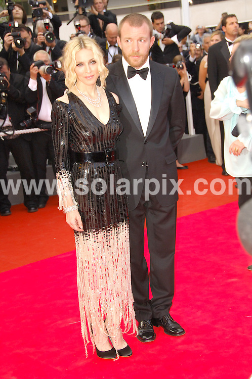 **ALL ROUND PICTURES FROM SOLARPIX.COM**.**WORLDWIDE SYNDICATION RIGHTS**.guests arrive for the premiere of 'Che' at the 61st Cannes Film Festival, Cannes, France. 21st May 2008..This pic: Madonna and Guy Ritchie..JOB REF: 6483 MSR    DATE: 21_05_2008.**MUST CREDIT SOLARPIX.COM OR DOUBLE FEE WILL BE CHARGED* *UNDER NO CIRCUMSTANCES IS THIS IMAGE TO BE REPRODUCED FOR ANY ONLINE EDITION WITHOUT PRIOR PERMISSION*