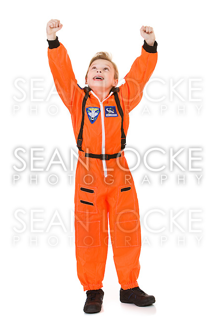 Young Caucasian boy, dressed in an astronaut costume, isolated on white.
