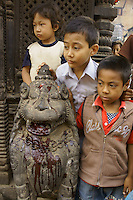 children watching killing of a buffalo as sacrifice for goddess Durga during dashein festival time in Bhaktapur, Nepal, October 2011.
