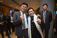 Hiroshi Mikitani, Chairman of the board of Tokyo Philharmonic Orchestra, left, and Eiji Oue, conductor of Tokyo Philharmonic Orchestra, attend the reception cocktail after the 100th Anniversary concert at the Esplanade Hall on 20 March 2014 in Singapore. Photo by Jerome Favre / studioEAST