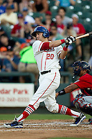 Wearing an Austin Senators throwback uniform, Round Rock Express third baseman Mike Olt (20) follows through on his swing during the Pacific Coast League baseball game against the Oklahoma City RedHawks on July 9, 2013 at the Dell Diamond in Round Rock, Texas. Round Rock defeated Oklahoma City 11-8. (Andrew Woolley/Four Seam Images)
