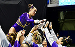 The SEC National Gymnastic Championship was held on Saturday March 24 at Chaifetz Arena on the Saint Louis University campus. Sarah Finnegan of LSU is congratulated by teammates after competing on the uneven bars.<br />