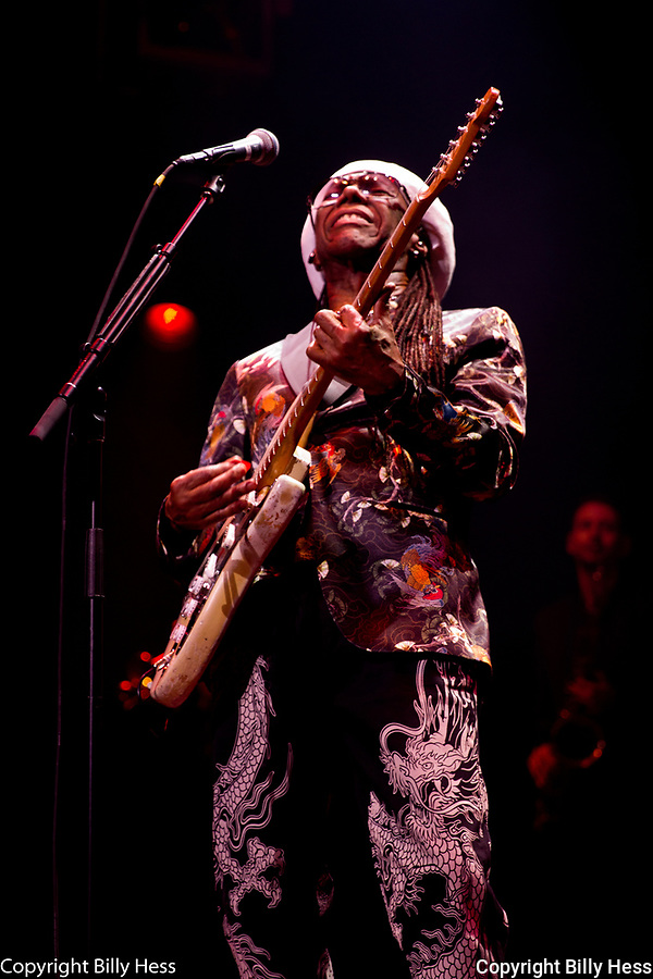 """Nile Gregory Rodgers Jr. is an American record producer, songwriter, musician, composer, arranger and guitarist. The co-founder of Chic, he has written, produced, and performed on records that have cumulatively sold more than 500 million albums and 75 million singles worldwide. He is a Rock and Roll Hall of Fame inductee, a three-time Grammy Award-winner, and the chairman of the Songwriters Hall of Fame. Known for his """"chucking"""" guitar style, Rolling Stone wrote in 2014 that """"the full scope of Nile Rodgers' career is still hard to fathom."""""""