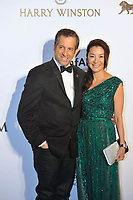 HONG KONG - MARCH 14:  amfAR Chairman Kenneth Cole (left) and Michelle Yeoh (right) arrive on the red carpet during the 2015 amfAR Hong Kong gala at Shaw Studios on March 14, 2015 in Hong Kong. Photo : Lucas Schifres/Abaca  (Photo by Lucas Schifres/Lucas Schifres)