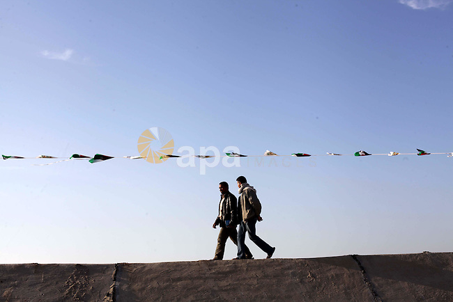 Palestinians walk on the bridge of wadi Gaza after opining it in central of Gaza strip on February 21, 2013. Bridge of wadi Gaza was destroyed during Israel's last military assault on the Gaza Strip. Photo by Ashraf Amra