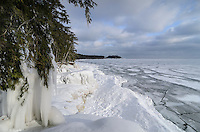 A beautiful morning view of the frozen Lake Superior shoreline near Little Presque Isle. Marquette, MI
