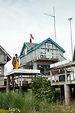 USA, Alaska, Homer, Ethan Martin, Halibut fisherman holds his catch at Land's End, the Homer Spit