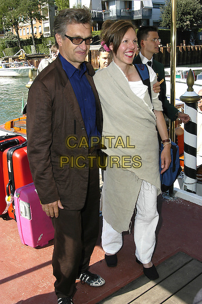 WIM WENDERS (DIRECTOR).61st Venice FIlm Festival,.September 7th 2004..full length sunglasses blue shirt trainers.Ref: KRA.www.capitalpictures.com.sales@capitalpictures.com.©Capital Pictures.