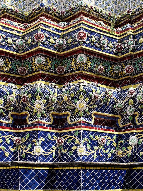 A section of the 42-meter high Chedi of Rama IV showing the detail and intricacy of the blue-based chedi decoration. The chedi is decorated with beautiful floral designs created with hundreds of ceramic flowers and vines in brilliant colors and a variety of patterns. Phra Maha Ched Cong Phra Srisuriyothai is the chedi's formal title.