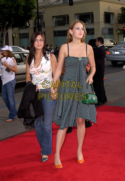 LEELEE SOBIESKI & FRIEND.New Line Cinema's World Premiere of 'Harold & Kumar Go to White Castle' held at The Mann's Chinese Village Theatre in Hollywood, California .July 27,2004 .full length, striped dress, green leather bag, orange shoes, holding hands.www.capitalpictures.com.sales@capitalpictures.com.Supplied By Capital Pictures