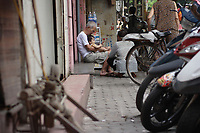 Hanoi<br /> , Vietnam - 2007 File Photo -<br /> <br /> An old vietnamese man sit with his grand child on his lap, in Hanoi.<br /> <br /> <br /> <br /> <br /> photo : James Wong-  Images Distribution
