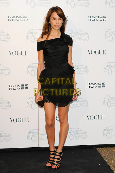 CAROLINE SIEBER.Attends the Range Rover 40th Anniversary Party in association with Vogue at the Orangery, Kensington Palace, London, England, UK..July 1st 2010.full length black dress off the shoulders strappy open toe shoes sandals clutch bag ruffle pleated peplum .CAP/CJ.©Chris Joseph/Capital Pictures.