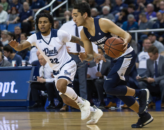 Utah State guard Ben Fakira (15) drives past Nevada guard Jazz Johnson (22) in the first half of an NCAA college basketball game in Reno, Nev., Wednesday, Jan. 2, 2019. (AP Photo/Tom R. Smedes)