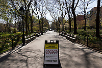 """NEW YORK, NY - APRIL 19: A sign is seen across Washington Square Park on April 19, 2020 in New York City. NY Governor Andrew Cuomo announced this week that the """"New York Pause State"""" order will continue until May 15. In addition, he announced that everyone should wear face masks and continue to use social distance in public places as infections continue to rise with nearly 130,000 infections and 8,800 deaths from COVID-19. (Photo by Pablo Monsalve/VIEWpress via Getty Images)"""