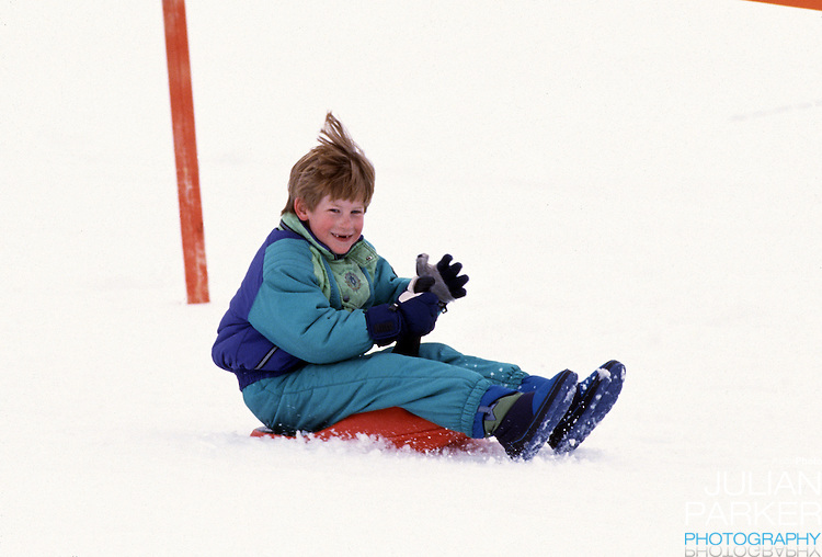 Prince Harry sledging, in Lech, Austria, with his brother Prince William, on an annual ski holiday with their mother, The Princess of Wales