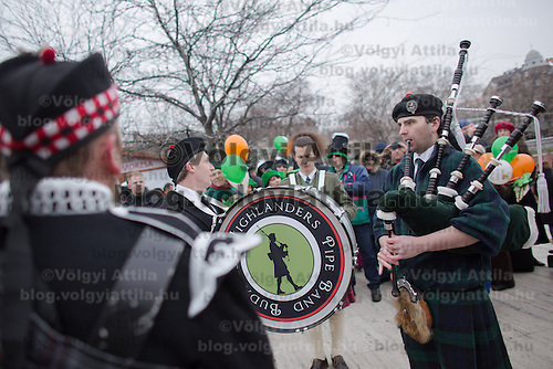 Bagpipers play music during a Saint Patrick's day celebration march in Budapest, Hungary on March 17, 2013. ATTILA VOLGYI