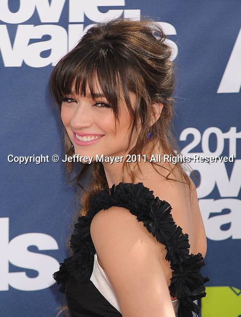 UNIVERSAL CITY, CA - JUNE 05: Crystal Reed arrives at the 2011 MTV Movie Awards at Universal Studios' Gibson Amphitheatre on June 5, 2011 in Universal City, California.