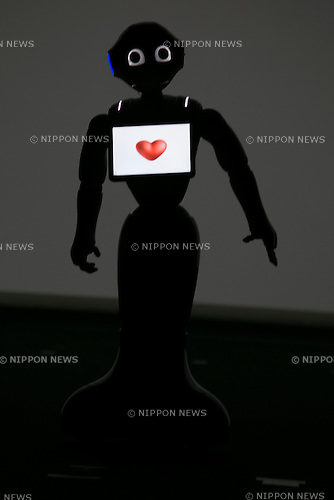 Robot Pepper performs during a press conference to announce that the SoftBank's robot ''Pepper'' can feel as human on June 18, 2015, Tokyo, Japan. Masayoshi Son chairman & CEO of Japanese internet and telecommunications giant SoftBank Corp., announced that its robot Pepper can feel and understand people's emotions and also express itself. Son also said that the first 1000 robots will be on sale to the public for 198,000 JPY (1,604 USD) from Saturday June 20th, and could be available to companies to replace positions such as reception and convenience store staff from the beginning of July. To develop Pepper's skills SoftBank announced an alliance with foreign technology companies FOXCONN and Alibaba Group. (Photo by Rodrigo Reyes Marin/AFLO)