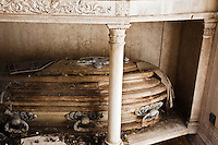 A decaying casket is testament to the neglect many of the tombs suffer in the Cementario de la recoleta in Buenos Aires.