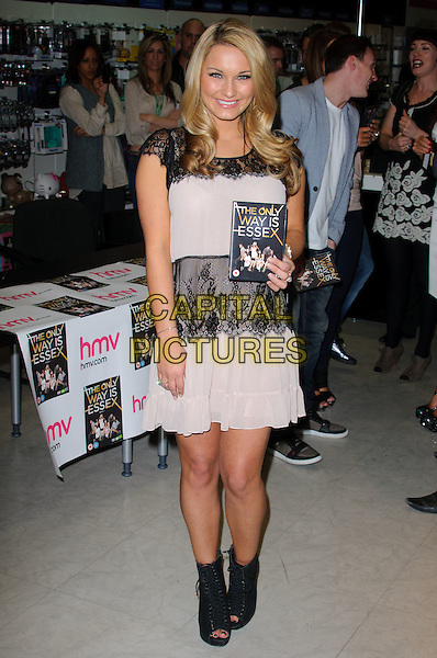 SAM FAIERS.Cast members at signing of The Only Way Is Essex DVD at HMV lakeside,  London, England..March 28th, 2011.full length dress open toe ankle boots beige black lace smiling.CAP/CJ.©Chris Joseph/Capital Pictures.