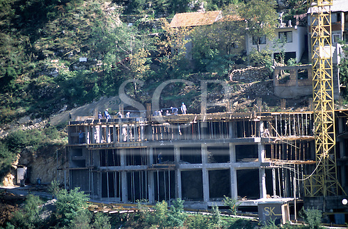 Nr Sarajevo, Bosnia and Herzegovina. Workers constructing a new concrete frame building.