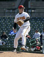 April 11, 2004:  Pitcher Adam Johnson of the Rochester Red Wings, Triple-A International League affiliate of the Minnesota Twins, during a game at Frontier Field in Rochester, NY.  Photo by:  Mike Janes/Four Seam Images