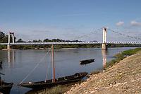 Bridge over the river. Typical boat. Cosne sur Loire, France
