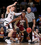 SIOUX FALLS, SD - MARCH 6:  C.J. Bobbitt #13 of Denver dribbles past Jake White #43 of Omaha in the 2016 Summit League Tournament. (Photo by Dave Eggen/Inertia)