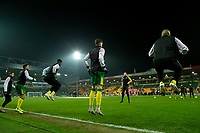 1st January 2020; Carrow Road, Norwich, Norfolk, England, English Premier League Football, Norwich versus Crystal Palace; Norwich City players during the warm up  - Strictly Editorial Use Only. No use with unauthorized audio, video, data, fixture lists, club/league logos or 'live' services. Online in-match use limited to 120 images, no video emulation. No use in betting, games or single club/league/player publications