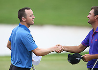 Michael Hoey (NIR) shakes hands with Jake Roos (RSA) as they complete Round Three of The Tshwane Open 2014 at the Els (Copperleaf) Golf Club, City of Tshwane, Pretoria, South Africa. Picture:  David Lloyd / www.golffile.ie