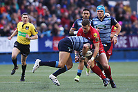 Scott Williams of Scarlets tackles Tom James of Cardiff Blues during the Guinness Pro 14 match between Cardiff Blues and Scarlets at the Cardiff Arms Park, Wales, UK. Sunday 31 December 2017