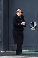 Gedenken am Dienstag den 19. Dezember 2017 anlaesslich des 1. Jahrestag des Terroranschlag auf den Weihnachtsmarkt auf dem Berliner Breitscheidplatz am 19.12.2016 durch den Terroristen Anis Amri.<br /> Im Bild: Bundeskanzlerin Angela Merkel kommt vom Gedenkgottesdienst in der Kaiser-Wilhelm Gedaechtniskirche und haelt eine Kerze in den Haenden.<br /> 19.12.2017, Berlin<br /> Copyright: Christian-Ditsch.de<br /> [Inhaltsveraendernde Manipulation des Fotos nur nach ausdruecklicher Genehmigung des Fotografen. Vereinbarungen ueber Abtretung von Persoenlichkeitsrechten/Model Release der abgebildeten Person/Personen liegen nicht vor. NO MODEL RELEASE! Nur fuer Redaktionelle Zwecke. Don't publish without copyright Christian-Ditsch.de, Veroeffentlichung nur mit Fotografennennung, sowie gegen Honorar, MwSt. und Beleg. Konto: I N G - D i B a, IBAN DE58500105175400192269, BIC INGDDEFFXXX, Kontakt: post@christian-ditsch.de<br /> Bei der Bearbeitung der Dateiinformationen darf die Urheberkennzeichnung in den EXIF- und  IPTC-Daten nicht entfernt werden, diese sind in digitalen Medien nach §95c UrhG rechtlich geschuetzt. Der Urhebervermerk wird gemaess §13 UrhG verlangt.]