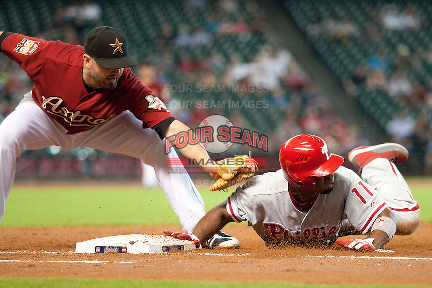 Philadelphia Phillies shortstop Jimmy Rollins #11 avoids the tag during the Major League baseball game against the Houston Astros on September 16th, 2012 at Minute Maid Park in Houston, Texas. The Astros defeated the Phillies 7-6. (Andrew Woolley/Four Seam Images).
