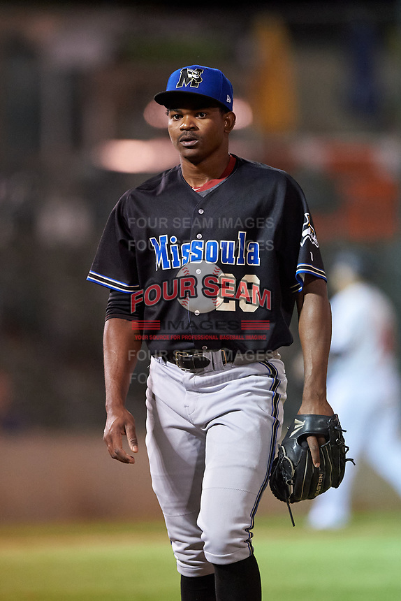 Missoula Osprey relief pitcher Jhonny Valdez (28) walks off the field between innings of a Pioneer League game against the Great Falls Voyagers at Centene Stadium at Legion Park on August 19, 2019 in Great Falls, Montana. Missoula defeated Great Falls 1-0 in the second game of a doubleheader. (Zachary Lucy/Four Seam Images)