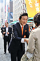 File Photo: Showing Miki Watanabe, candidate for the April 10 Tokyo Gubernatorial Election. Official campaigning starts on March 24th and there are five candidates in the race. Pictured Japanese business entrepreneur Miki Watanabe distributes his cards to passers-by as he takes to the streets of Tokyo following the opening of his election office on Monday, March 7, 2011. Watanabe is the founder of a chain of casual pubs, and attempting to make the big jump from business manager to big-time politician. (Photo by Masahiro Tsurugi/AFLO) [2910] -mis-