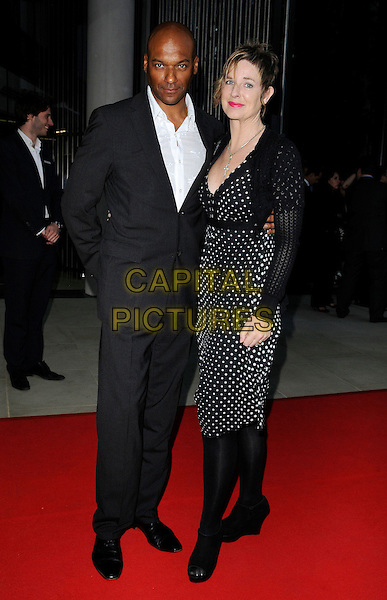 Colin Salmon & Fiona Hawthorne.attending the McLaren Automotive Showroom Launch at One Hyde Park, Knightsbridge, London, England, UK, June 21st 2011..full length grey gray suit white shirt husband couple wife polka dot dress shrug ankle boots wedges couple .CAP/CAN.©Can Nguyen/Capital Pictures.