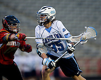 Ian Braddish (35) of North Carolina is defended by Bryn Holmes (17) of Maryland during the ACC men's lacrosse tournament semifinals in College Park, MD.  Maryland defeated North Carolina, 13-5.