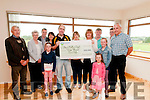 Clounmacon Lotto: John Walsh, Chairman Clounmacon GAA club presenting a cheque for €20.000.00 to Marie O'Sullivan Doyle, Wexford, the winner of the recent lotto draw at the Clounmacon GAA clubhouse on Saturday last. L-R : Michael O'Sullivan, Ella O'Sullivan, Michael O'Sullivan, Ella Doyle, Bridget Molyneaux, John Walsh, Siobhan O'Sullivan, MarieO'Sullivan Doyle, John O'Sullivan, Chloe & Amy Doyle,Conor O'Sullivan & PJ Doyle.