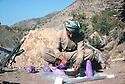 Iran 1979.Headquarters of KDPI near the Iraqi border: Peshmerga fixing sugar for the tea