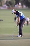 Padraig Harrington takes his putt the 18th green during  Day 3 at the Dubai World Championship Golf in Jumeirah, Earth Course, Golf Estates, Dubai  UAE, 21st November 2009 (Photo by Eoin Clarke/GOLFFILE)