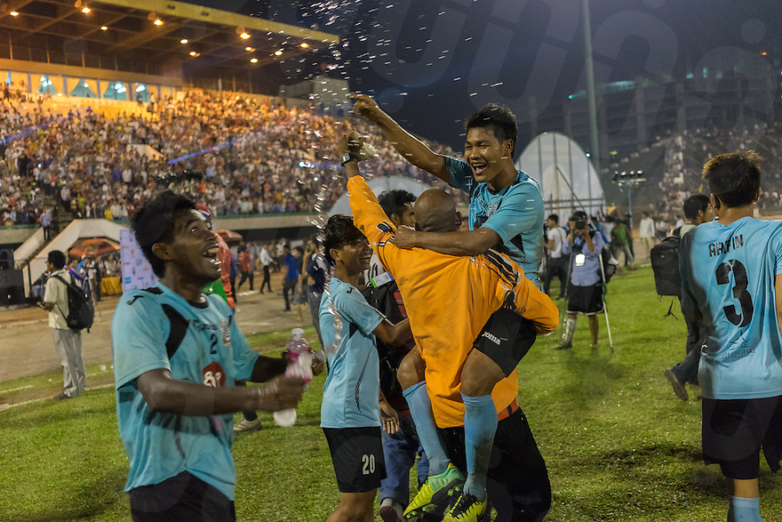 March 15, 2014 - Phnom Penh. Samuel Oseika cheers in support of his team, National Police FC, during the Hun Sen Cup final, National Olympic Stadium, Phnom Penh. © Thomas Cristofoletti / Ruom.