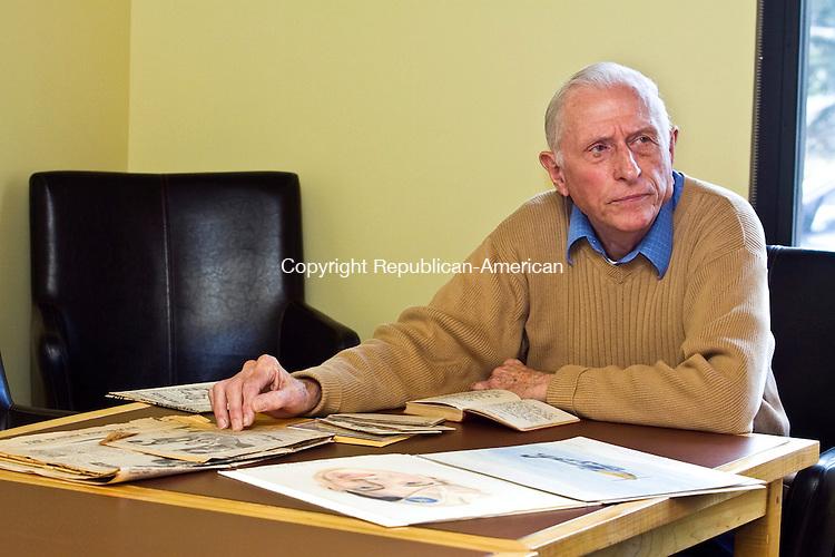 LITCHFEILD CT.-09 NOVEMBER 2010 110910DA03-  Lloyd Wellnitz of Litchfield sits at a table full of memorabilia as he remembers back to World War II.<br /> Darlene Douty Republican-American