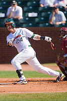 Yasmani Grandal #24 of the Miami Hurricanes follows through on his swing against the Florida State Seminoles at the 2010 ACC Baseball Tournament at NewBridge Bank Park May 26, 2010, in Greensboro, North Carolina.  The Hurricanes defeated the Seminoles 9-3.  Photo by Brian Westerholt / Four Seam Images