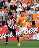 Chivas USA defender Claudio Suarez (2) chases Houston Dynamo forward Brian Ching (15).  The Houston Dynamo tied CD Chivas USA 0-0 at Robertson Stadium in Houston, TX on May 3, 2008.