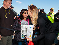 Feb 23, 2019; Chandler, AZ, USA; NHRA top fuel driver Leah Pritchett signs autographs for a young female fan during qualifying for the Arizona Nationals at Wild Horse Pass Motorsports Park. Mandatory Credit: Mark J. Rebilas-USA TODAY Sports